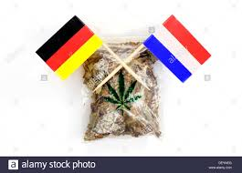 Marijuana Flags Bag Of Marijuana With The Flags Of Germany And The Netherlands