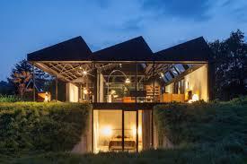The Modern House Slope Houses Designs Inspiration Photos Trendir Stunning Steep