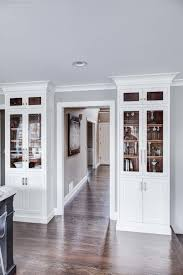 white kitchen cabinets with wood interior wrought iron kitchen island and white cabinets in towaco