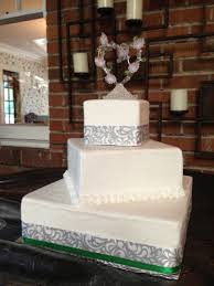 off square wedding cake with ribbon