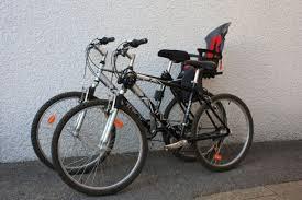vélo avec siège bébé location deux vtt homme ou femme un avec porte bébé à villaz