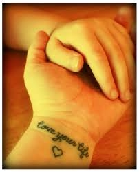 pretty things a wrist tattoo words to live by