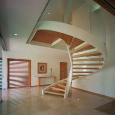 unique floating light wooden circular staircase with glass railing