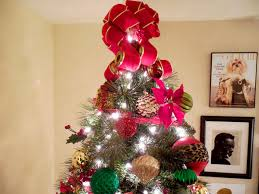 traditional christmas tree decorated with plaid and leopard print