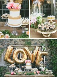 gold love balloons behind the dessert table great for a bridal