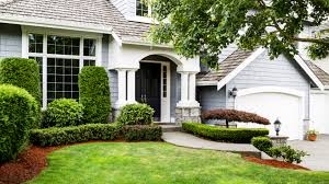 nice front yard landscaping with concrete walkway and expanse
