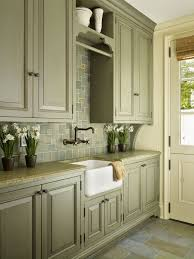 what color goes with green cabinets the color and the sink green kitchen cabinets
