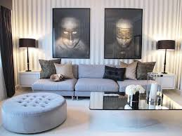 Gray And Tan Living Room by Living Room Gray Sofa White Futons Gray Rug White Pendant Lights
