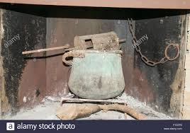 old fireplace of a country house inside an old copper pot with