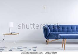 white room pattern carpet blue sofa stock photo 581220730