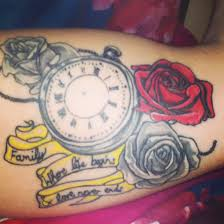 inner bicep timepiece and roses with family quote my