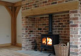 5 clearview pioneer wood burning stove with brick arch and beam
