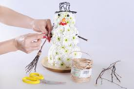 snowman craft idea with white chrysanthemums to make this christmas