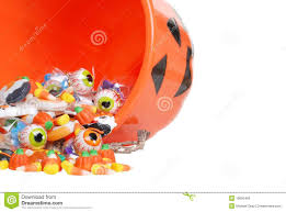 macro spilled halloween candy and pumpkin bucket royalty free