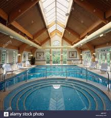 hotel indoor swimming pool with large window with a view to the