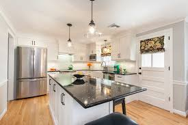 light wood kitchen cabinets with black hardware after shaker cabinetry and flat black hardware