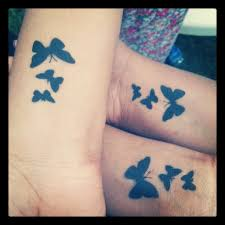 silhouette butterfly tattoos on wrists tattoos piercings