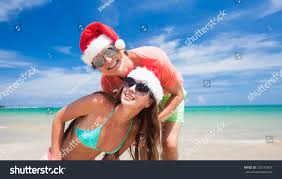 young couple santa hats laughing on stock photo 226147891