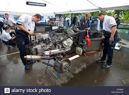 formula renault race technicians tinker with the car engines in the formula