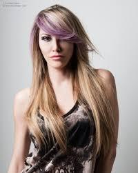 long blonde hair with a purple streak in the side fringe