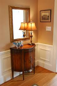magnificent small wooden foyer table with curved door as well as