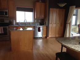 kitchen cabinets wood floor and trim baseboard colors