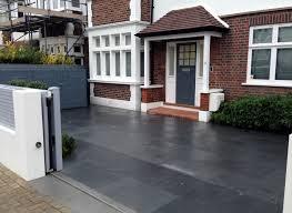 driveway car space paving granite bike bin store white wall grey