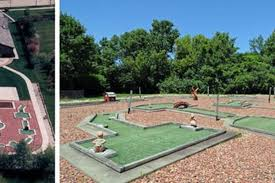 suburban house has a 9 hole mini golf course in the back yard