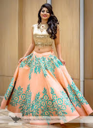 golden blouse smashing blue embroidered lehenga with contrast golden blouse