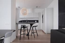 kitchen ultramodern black and white kitchen features black island
