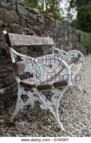 Wrought Iron Bench Wood Slats Empty Wrought Iron Bench With Wooden Slats Situated In Garden