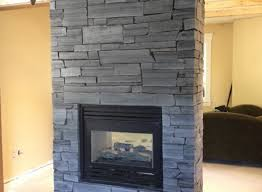 natural stone fireplace black saw cut natural stone fireplace by rr masonry lethbridge ab