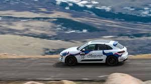 Porsche Macan Blue - scaling pikes peak in the new porsche macan gts the drive