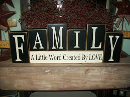 primitive family a little word created by love wood sign shelf