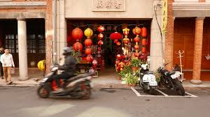 small building entrance decorated with many paper chinese lantern