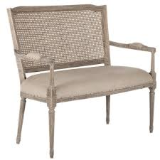 this chic bench features a cane back and comfy seat covered in a