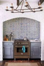 white mosaic tile kitchen backsplash hood with curved gray
