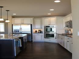 dark wood flooring white kitchen comfy home design