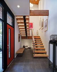 Staircase Design Inside Home by Half Century Rancher Renovated Into Large Modern 2 Story Home