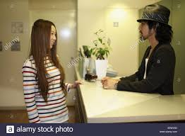 Free Standing Reception Desk Receptionist And Woman Standing At Reception Desk In Hairsalon