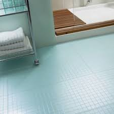light blue mosaic tiles flooring for bathroom with movable bath