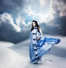 woman in purple dress walking on winter hills royalty free stock