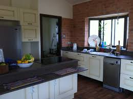 kitchen and cabinets by design my new kitchen with wild rice caesarstone countertops cabinets by