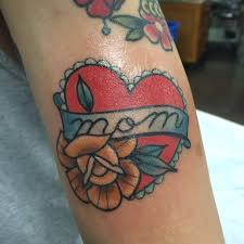 hearth tattoo mom dad one heart tattoo on right shoulder