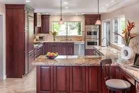 what color granite looks best with cherry cabinets typhoon bordeaux granite in your kitchen