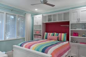 bedroom bedroom storage ideas with crown moulding and ceiling fan