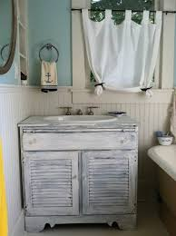 nautical themed bathroom accessories white solid vanity fish net