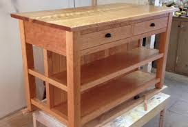 a kitchen island cherry base curly birch top knee hole for bar