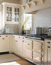 Yellow Kitchen With White Cabinets - why white kitchen cabinets are the right choice the decorologist
