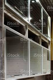 wall mounted kitchen display cabinets wallmounted kitchen cabinets with glass doors closeup selective focus modern fashionable furniture stock photo image now
